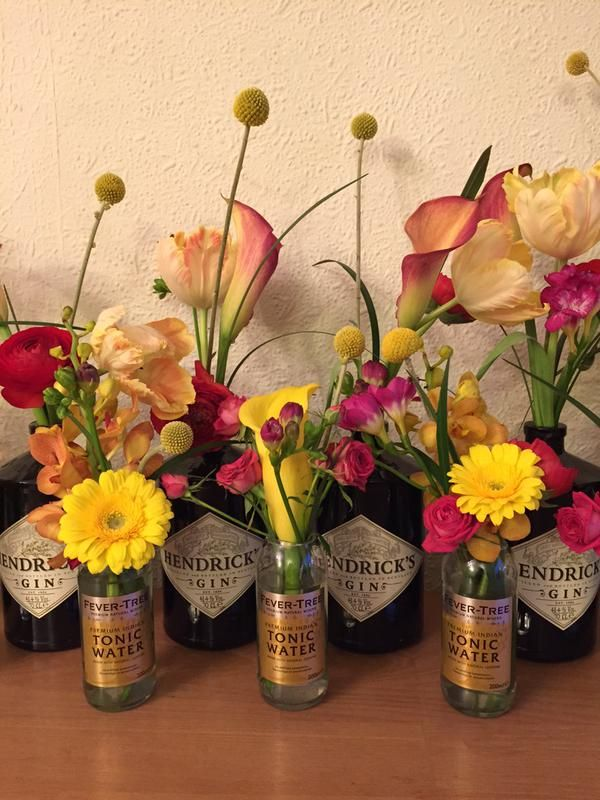 Not strictly speaking wine bottles - but a beautiful display of wedding flowers using Hendricks Gin & Fever Tree Tonic Bottles.