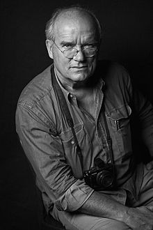 Peter Lindbergh, is a German photographer working internationally for Vogue, first the Italian, then the English, French, German, and American Vogue, later for The New Yorker, Vanity Fair, Allure, and Rolling Stone. His mostly black-and-white photographs, implement a pictorial language that takes its lead from early German cinema and from the Berlin art scene of the 1920s.