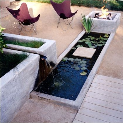 A water feature and fire pit by Dry Design (http://www.drydesign.com)