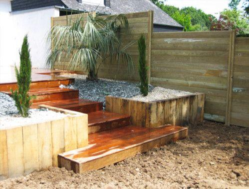 Cr ation d 39 une terrasse en bois et d 39 un am nagement for Jardin paysager avec terrasse