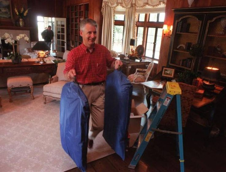 Kansas Gov. Bill Graves carries some of his belongings into the newly-refurbished Cedar Crest in Topeka, Kan., Thursday, May 11, 2000. The Kansas governor's mansion has undergone an 18-month, $4.3 million renovation and will open for public tours June 19. (AP Photo/The Topeka Capital-Journal, Greg Lahann)