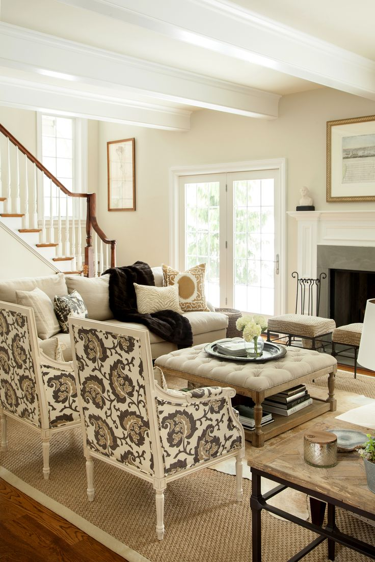 Neutral living room, hip traditional, large scale print on chairs, two sofas facing each other - Design Manifest Chestnut Hill Family Room