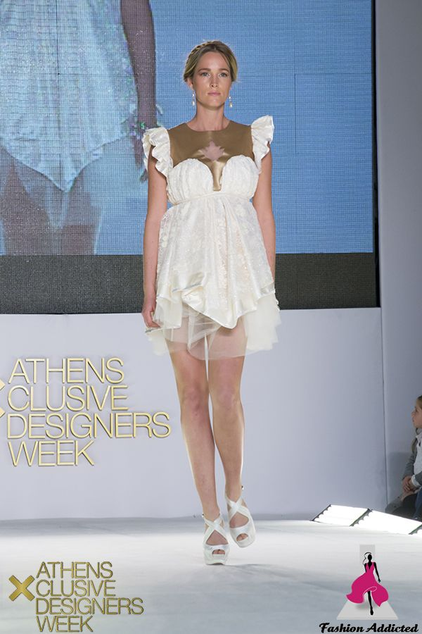 White fluffy dress consisting of three different layers of fabrics (embellished sparkling lace, satin, tulle). On the top of the dress there is bronze leatherette.