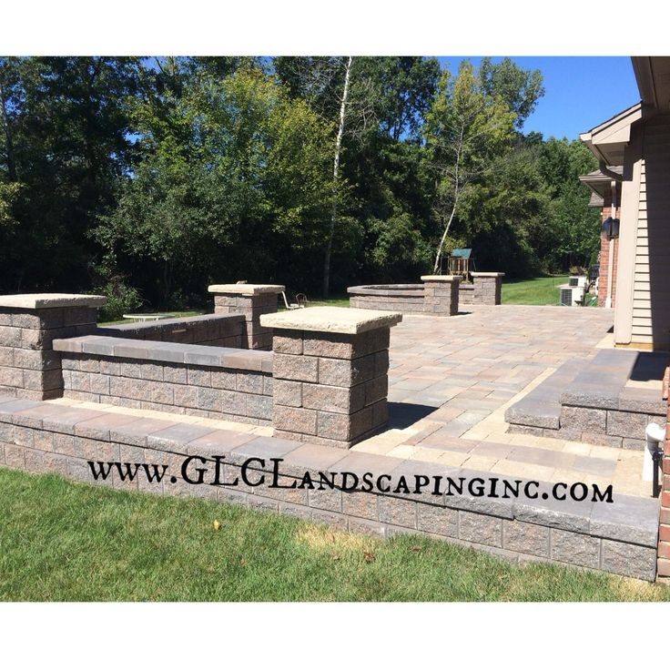 brick paver patio back yard landscaping raised patio seat walls