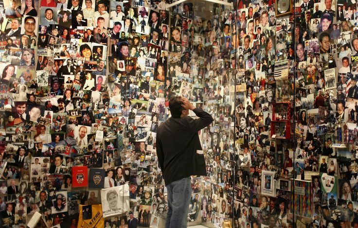 David Filipov looks for a picture of his father, Al Filipov, at the Tribute WTC Visitor Center in New York City. The center is run by the September 11th Families Association as a museum and memorial to the victims and history of the World Trade Center and the 9/11/2001 attacks. Filipov's father was on American Airlines Flight 11, the first plane flown into the towers. (Scott Lewis)