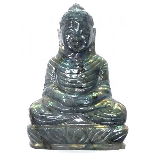 Lord Buddha Hand Carved On Natural Labradorite Gemstone from Mahavir Gems  This Lord Buddha statue is a one of a kind sculpture, hand carved by our artists using hammer and chisel on a natural Labradorite Gemstone.   Buy online Lord Buddha artistically hand carved on natural Labradorite - 223 grams / 1115 carats