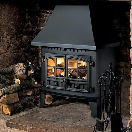 The Hunter Inglenook Multi Fuel / Wood Burning Stove produces a heat output of between 5Kw and 7.5Kw.  It's ideal for the larger fireplace in a fairly small room and is designed to burn logs and smokeless fuel cleanly and efficiently.  A canopy option is available.