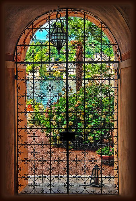 Wrought-iron door to the patio of a palazzo in Italy.