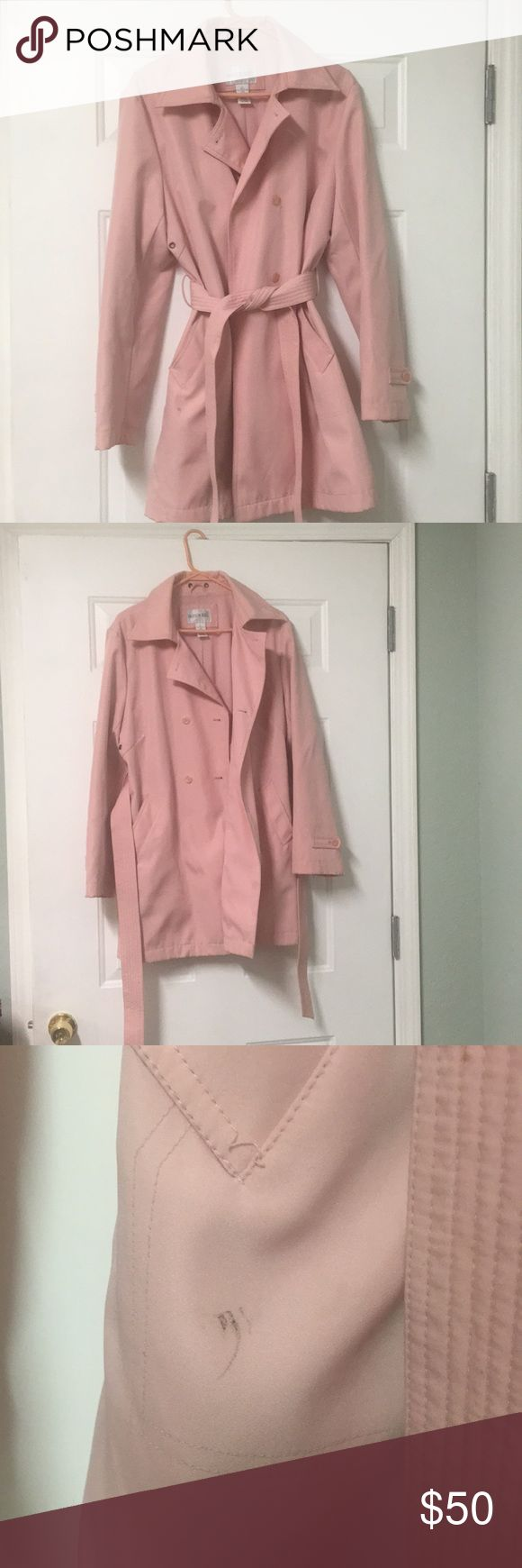 Fashion Bug Knee Length Rain Coat Women's Large This coat is waterproof and absolutely wonderful! If I weren't moving out of the country I wouldn't be parting with it! But it needs a good home! A couple stains (shown in pictures) but I've never tried to wash it honestly and it is machine washable. Open to offers. Let me know if you'd like to see more pictures! Fashion Bug Jackets & Coats Trench Coats