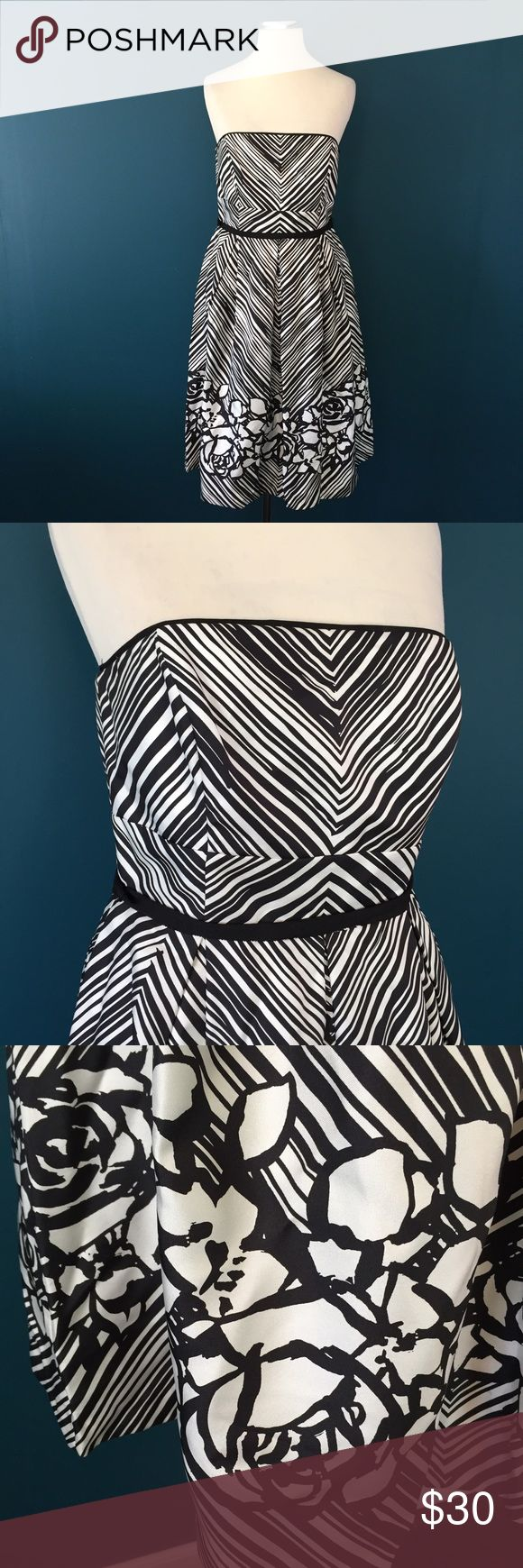 White House Black Market Silk Dress Sz 4 Worn once!  Gorgeous dress  100% silk  Back zip Lined  Boning in bust for support  Black ribbon belt Adhesive strip along top hem to prevent slips  Measurements in inches when laid flat:  Bust: 15 Waist: 14 Hips: 20 Length from under arm to hem: 29 White House Black Market Dresses Strapless