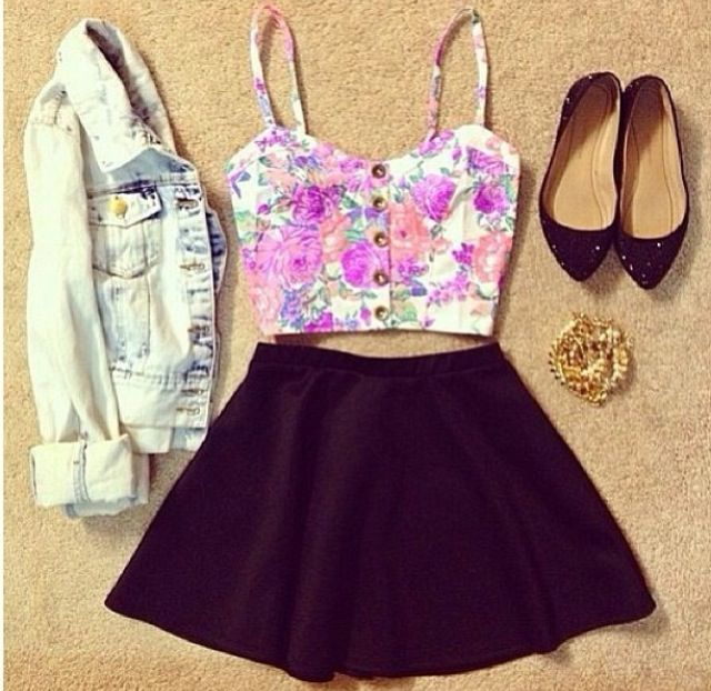The bright colors in the top with the deep red of the skirt are so pretty