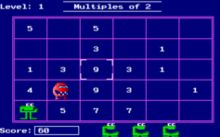 A screenshot from the Number Munchers game (DOS version) showing the muncher and a troggle monster in the playfield.