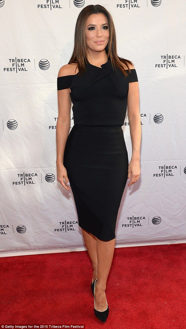 Chic: Cutting a chic figure during the photo call, Eva's black dress' bodice featured off-the-shoulder and asymmetrical straps and cut-outs along the back