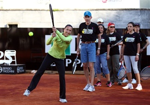 Jelena Jankovic of Serbia takes part in a record attempt for the most amount of participants in a rally during day one of the Internazionali BNL d'Italia 2012 Tennis on May 12, 2012 in Rome, Italy.