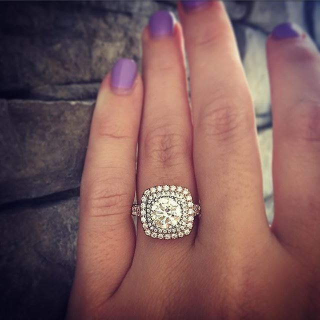A cushion shaped double halo engagement ring with a round diamond? Perfection.