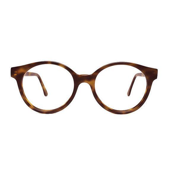 These matte Habana brown tortoise round vintage eyeglasses ...