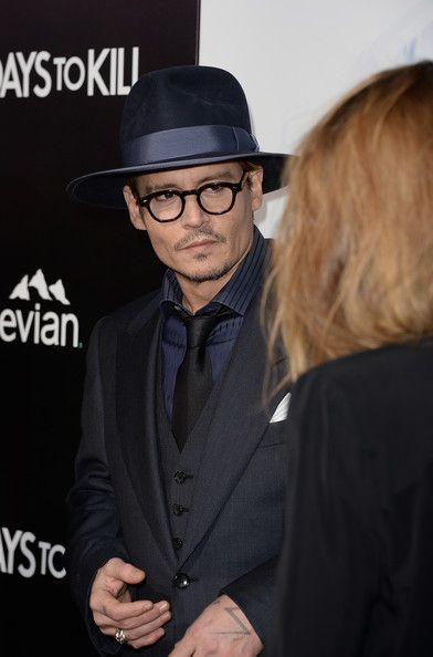 "Johnny Depp and Amber Heard - Premiere Of Relativity Media's ""3 Days To Kill"" - Arrivals"