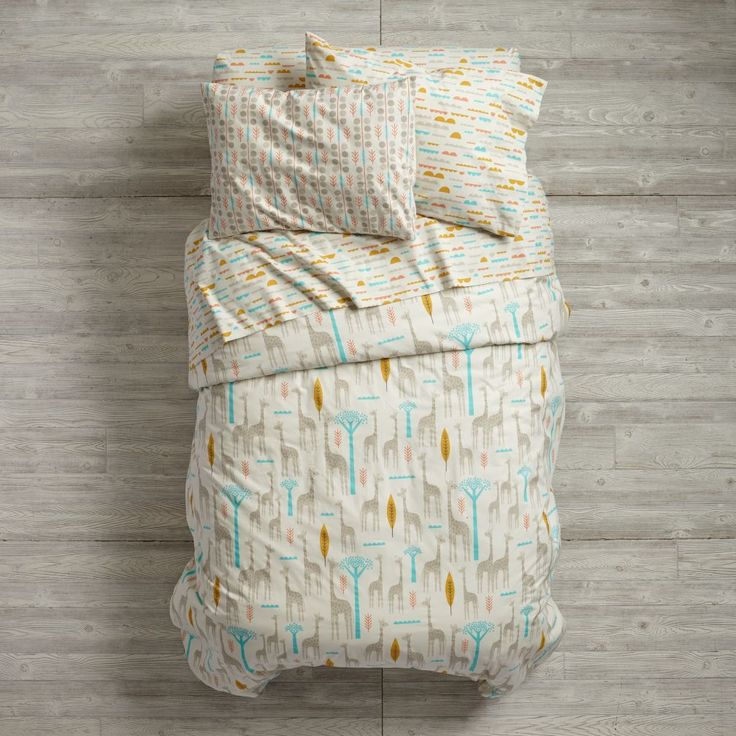 Shop High Plains Organic Kids Bedding.  Our High Plains Organic Kids Bedding features an all-over print, while the sheet set includes giraffes, trees or clouds.  Shop for unique kids bedding today.