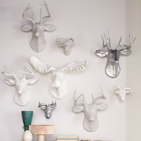 Papier-Mâché Animal Sculptures   west elm...My husband and I both loved these had to get the 3 white ones for our family room