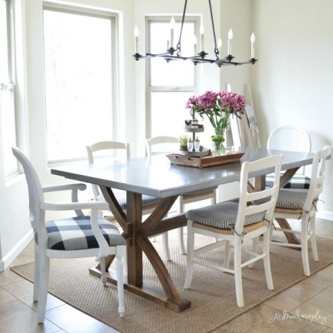 Love this wood and stainless steel dining table - the perfect mix of farmhouse and industrial eclecticallyvintage.com