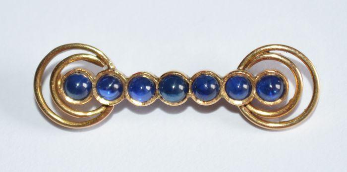 Online veilinghuis Catawiki: Geelgouden broche bezet met ronde blauwe stenen