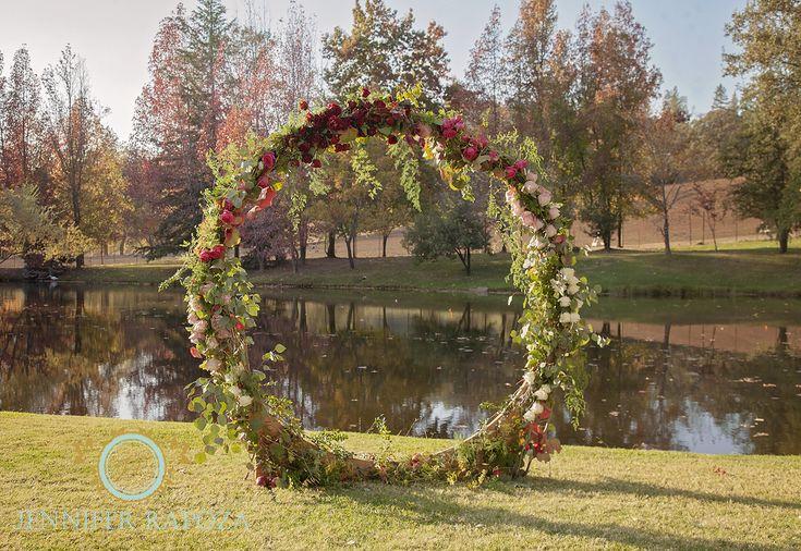 Floral arch created by Sweet Lilacs Studio. Ironstone Vineyards, Murphys, California creative photo shoot. #jenniferrapozaphotography #sonoraphotographer #calaverasphotographer #ironstonevineyards #sweetlilacsstudio #floralcirclearch
