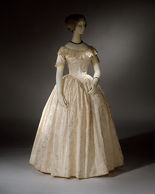 http://www.metmuseum.org/ Ensemble, Evening  Date: ca. 1845 Culture: British Medium: silk Dimensions: Length at CB (a): 15 5/8 in. (39.7 cm) Length at CB (b): 11 1/4 in. (28.6 cm) Length at CB (c): 41 1/2 in. (105.4 cm) Credit Line: Purchase, Irene Lewisohn Trust Gift, 1985 Accession Number: 1985.140.3a–c