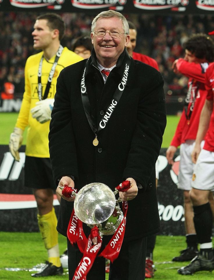 Alex Ferguson poses with the Carling Cup trophy after the Final match between Manchester United and Tottenham Hotspur at Wembley Stadium on March 1 2009