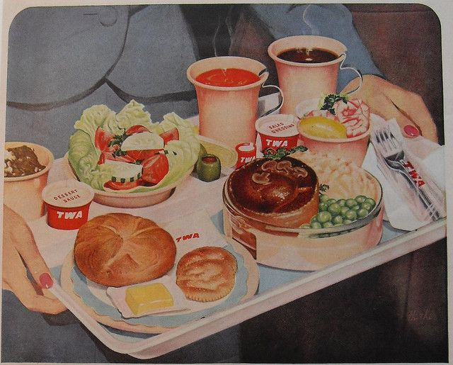 Enough food to feed a small family, all served up for one Trans World Airlines passenger during the 1950s.