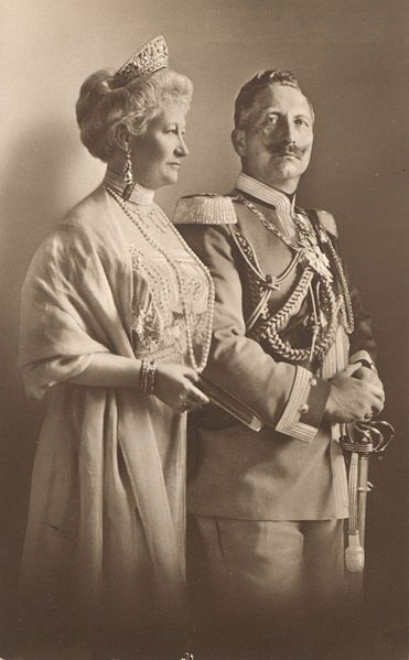 """Kaiser Wilhelm II (1859-1941) & 1st wife Auguste Victoria """"Dona"""" (1858-1921) on a German Postcard by T. Voigt in 1910. Auguste died shortly after word came of the suicide of her beloved son Joachim (1890-1920).  Her body was sent back to Germany for burial the Kaiser having to say his last farewell at the Dutch border & even in the new republican Germany her loss was an occasion of great mourning."""