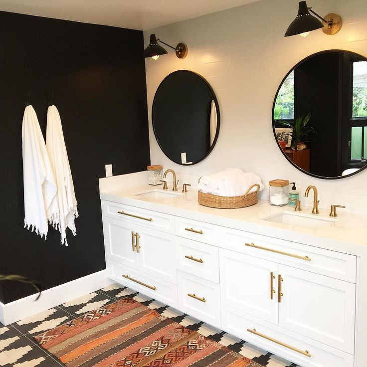 """So beyond thrilled to share this awesome black and white bohemian bathroom. The black wall worked out and I love the special fringe towels from @503found.…"""