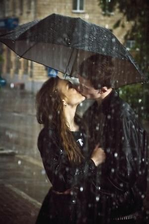 Kissing in the rain love cute kiss rain outdoors couple by Hercio Dias