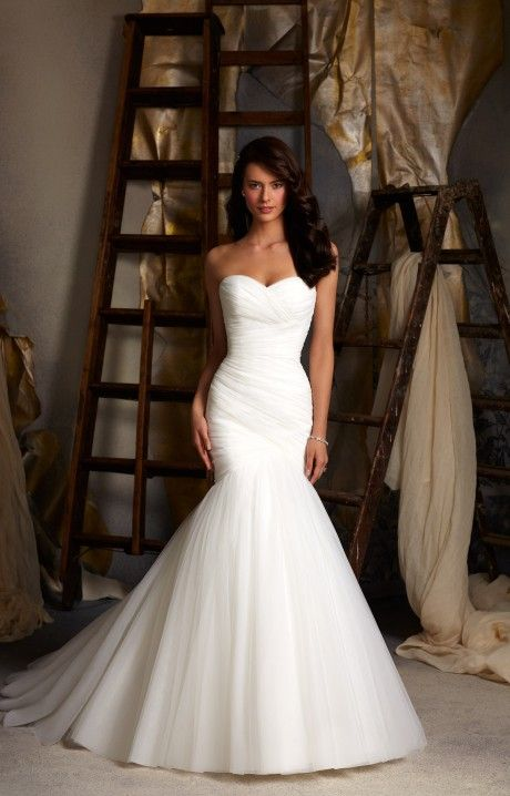 Mori Lee Blu 5108 is a gorgeous wedding gown! It is a fit and flare mermaid type style with a corset back. It is so simple yet so elegant. The bodice is delicately ruched and the corset back pulls the dress in for a nice fit. We love Mori Lee 5108 and we know you will too!