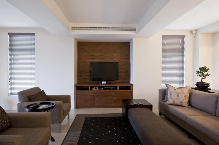 Feature wall, TV display, couch with foot rest cushion
