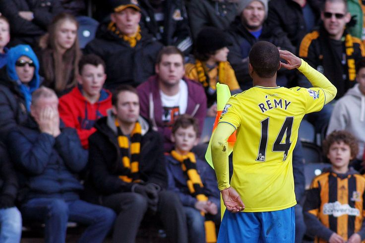 Hull City AFC 1 Newcastle United FC 4: Loic Remy salutes the second Newcastle goal, watched by less enthusiastic Hull fans.