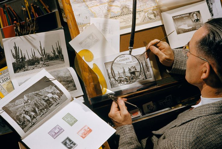 Picture of a government artist designing a stamp from old magazine art.