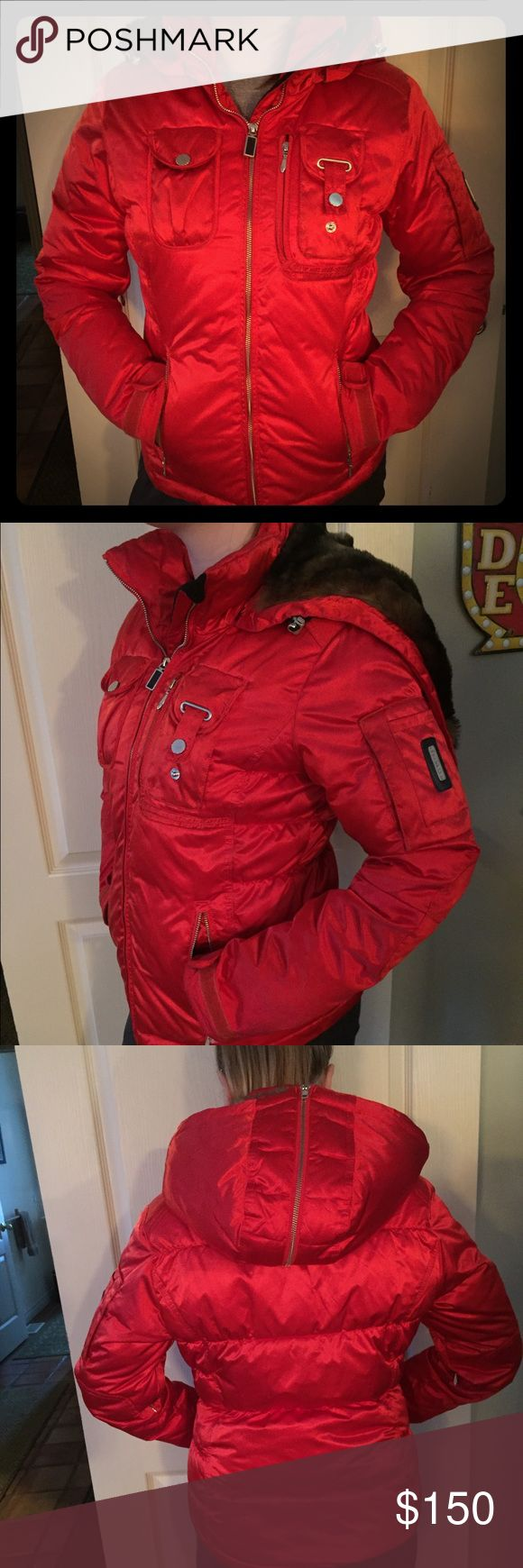 Obermeyer Red Satin Ski Jacket With its unique satin finish, this beautiful Obermeyer Leighton jacket will keep you toasty warm and looking good on the slopes or in town. It features Fiber Down insulation (100% polyester), waterproof exterior and all the technical specs you expect from a brand like Oberneyer. The faux-fur-lined hood is removable and also can be unzipped to lie flat. For an added touch the interior lining features a fun cheetah print. This jacket is in fair condition. Size 8…