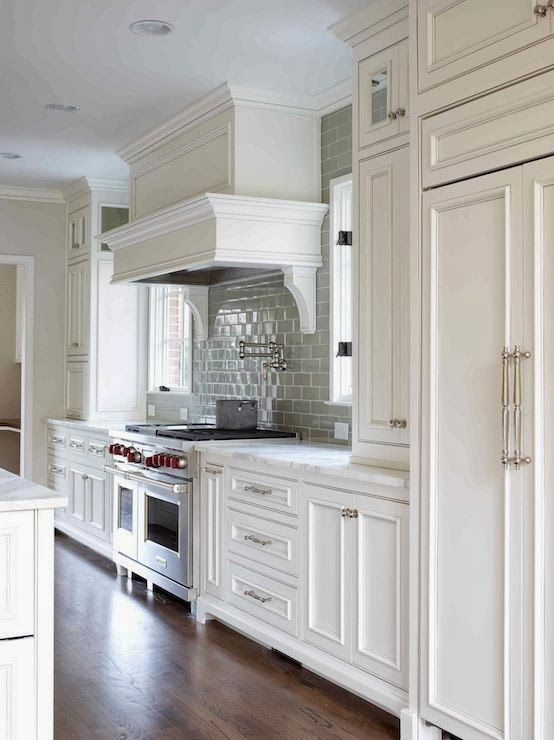 love this kitchen white kitchen  of  like hardwood floor color white paneled hood with swing arm pot filler wolf stove cabinets installed over : beautiful white kitchen cabinets