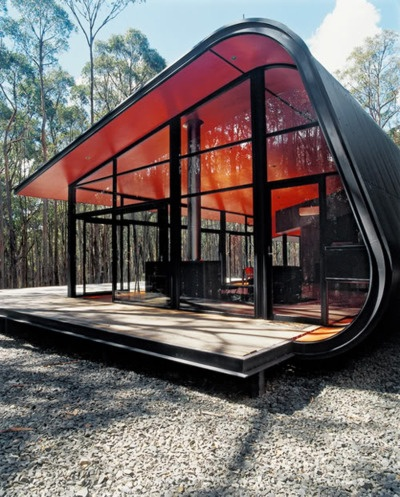The Wheatsheaf house by Jesse Judd is a spectacular piece of architecture in Daylesford Victoria. Ideas inspired by old plywood caravans and bus shelters were translated into a steel, laminated glass and plywood cocoon. The interiors are stained plywood forming a striking frame for the modern furniture within. It's an organic, truly magical building.