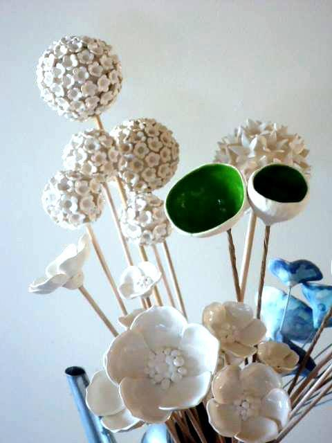 Ceramic flowers by Bronwen Holding - Bron's Ceramics Find more here: http://www.madeit.com.au/Main/Store?storeId=15386&userId=100707