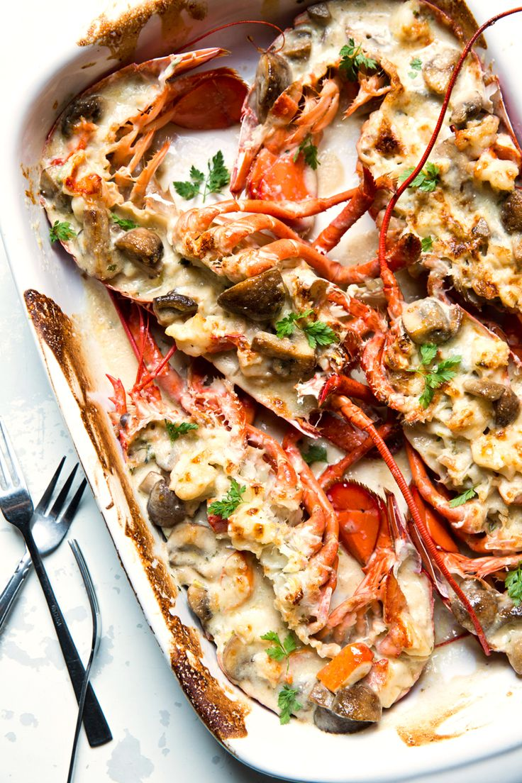 The signature dish at the Cape Cod Room in Chicago's famed Drake Hotel features chunks of tender lobster and mushrooms swathed in a mustard–cream sauce, placed in a lobster shell, and broiled under a Gruyère crust.