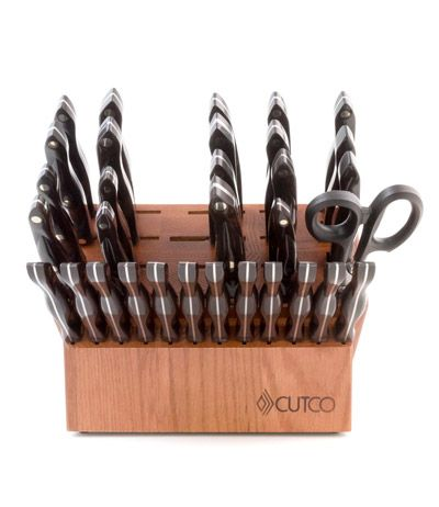"Cutco Ultimate Set & Steak Knives with Cherry Block Includes: 2-3/4"" Paring Knife 4"" Paring Knife Trimmer Butcher Knife 9"" Carver 6-3/4"" Petite Carver 9-3/4"" Slicer 7-3/4"" Petite Slicer 9-1/4"" French Chef 7"" Santoku Vegetable Knife Cleaver Hardy Slicer Boning Knife Salmon Knife Spatula Spreader Super Shears Traditional Cheese Knife 12 Steak Knives Turning Fork Carving Fork Sharpener Large, Medium & Small Cutting Boards Honey or Cherry Finish Oak Block"