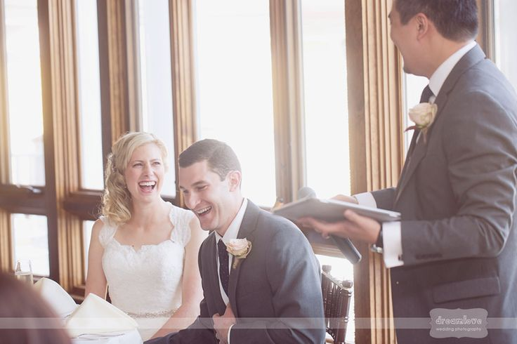 Great photo of the bride and groom laughing from a funny groomsman's speech at a wedding reception at the Bedford Village Inn in NH... this barn venue is perfect for a laid back and rustic wedding in southern New Hampshire.