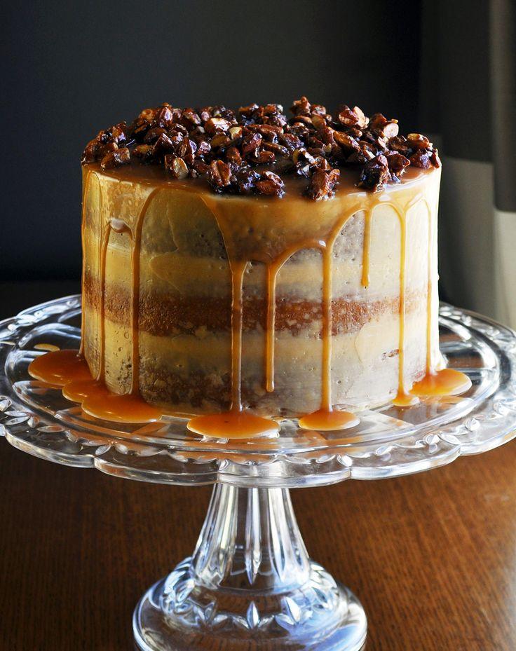 Gluten Free Birthday Cake with 3 layers of caramel cake, salted caramel Italian meringue buttercream, salted caramel sauce & almond pralines.