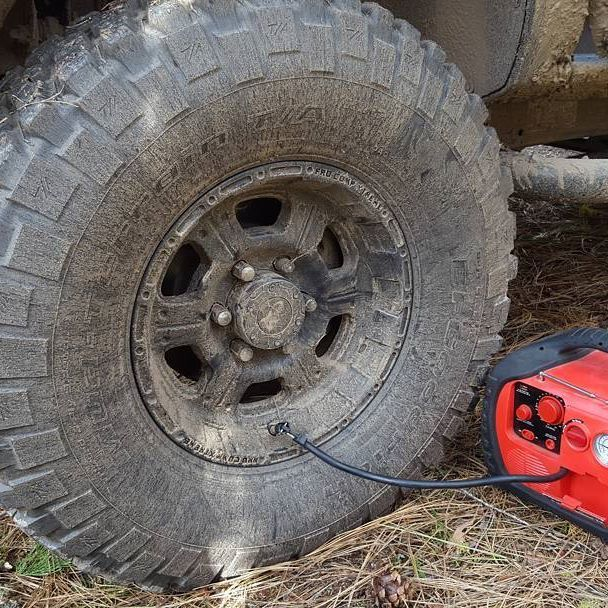 "Wagan Tech Power Dome EX topping off 35"" tire number 4.  It may not look like much, but the heavy duty air compressor inside can handle a lot of work...and we certainly like to give them a good workout! *  *  *  #offroad #offroading #4x4 #expedition #expeditionoffroad #truck #4wheeldrive #trucks #mud  #trailsoffroad #mudding #prerunner #bigtrucks #powerdome #adventure #roamtheearth #explore #overland #overlanding #jeep #trails #wagan #wagantech #optoutside #35s"