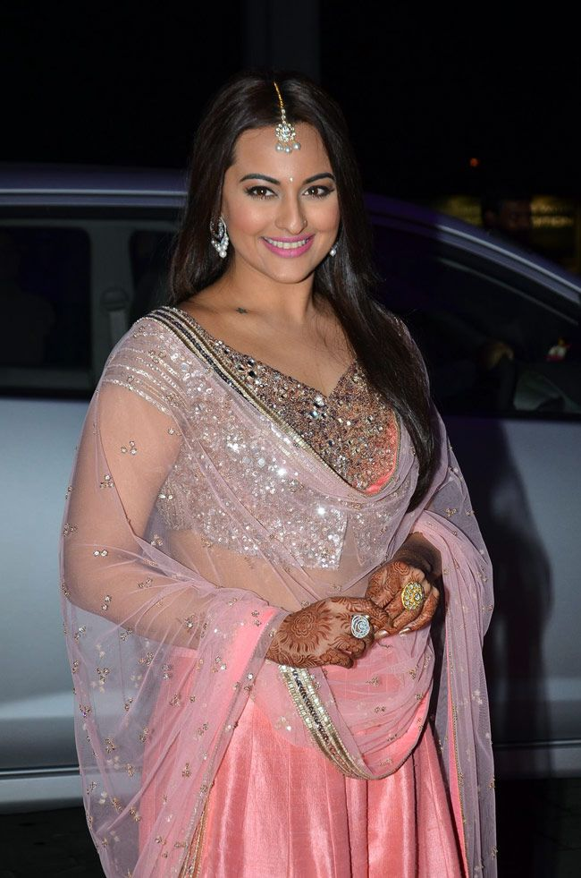 Sonakshi Sinha in a salmon pink lehenga at her brother Kush Sinha's wedding reception.