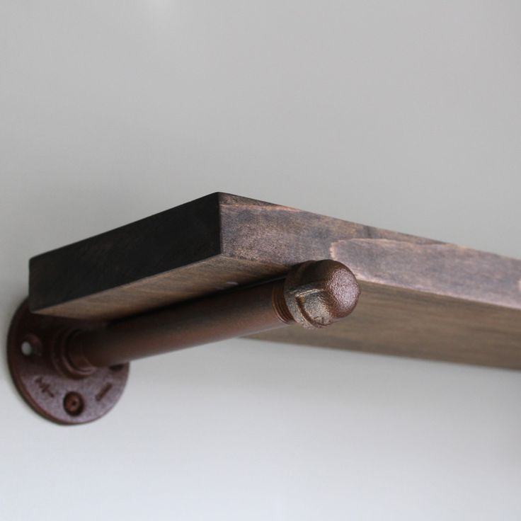 This is only one of the several new items coming out within the next two weeks. This pipe shelf is showcasing a rustic rusty brown pipe with a beautiful dark walnut stain.