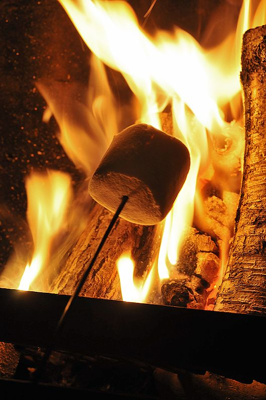 Roasting marshmallows around the campfire.  I can hear the fire popping & sizzling right now.