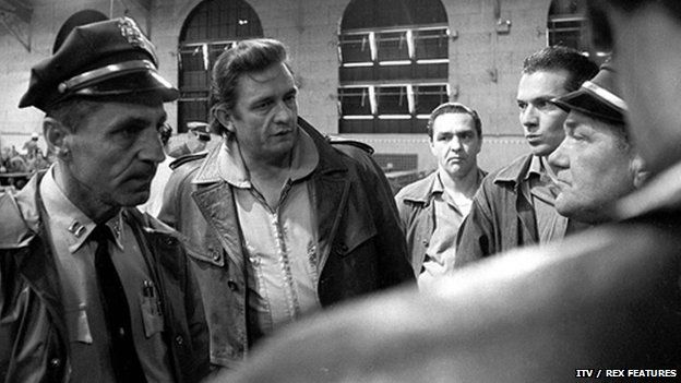 Johnny Cash and his prison reform campaign  .......Johnny Cash talking to prison guards at San Quentin prison