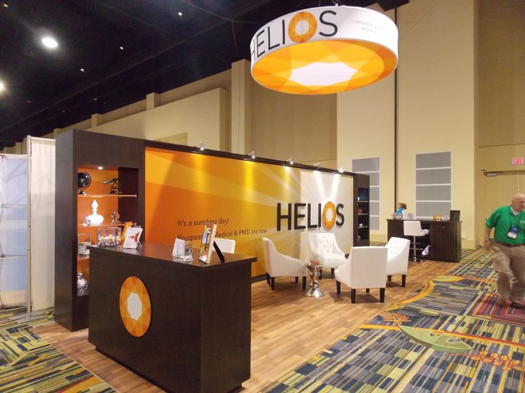 Helios Creates Trade Show Lighting Texture With Spotlights Pointing Down At  Their Graphics.